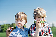 Two boys outdoors eating watermelon - MJF001939