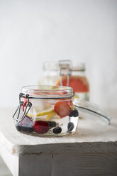 Preserving jar of cooled water flavoured with different fruits - MYF001596