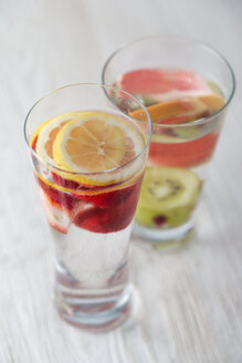 Two glasses of water flavoured with different fruits - MYF001599