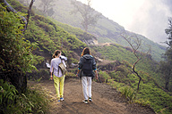 Indonesia, Java, Two women hiking in the mountains - KNTF000395