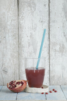 Glass of pomegranate juice and half of pomegranate - ASF005917