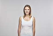 Portrait of smiling blond woman wearing white top - RHF001641