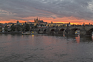 Czechia, Prague, Sunset over Prague Castle and Charles Bridge - MELF000129