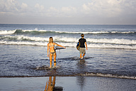 Indonesia, Bali, Surfers on the beach - KNTF000403