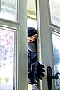 Burglar peeking at front door - MAEF011859