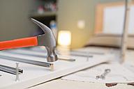 Hammer over wood peg, assembling furniture - RAEF001253