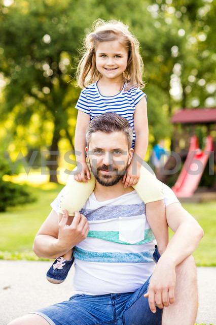 Portrait of father with little daughter on his shoulders - HAPF000554