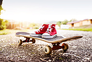 Red sneakers on a skateboard - HAPF000590