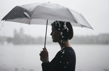Woman with umbrella on a rainy day - DASF000053