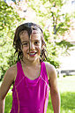 Portrait of smiling little girl with wet hair - LVF005054
