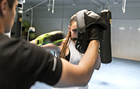 Young woman in gym doing boxing training - MGOF002011