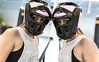 Young woman with head guard in gym - MGOF002020