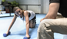 Young woman in gym doing strength training - MGOF002029