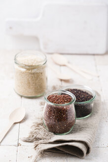 Three glasses of different quinoa - MYF001679