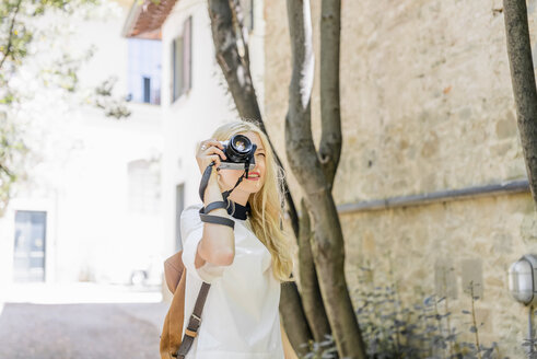 Blond woman photographing with camera - FMOF000049