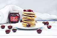 Stack of American pancakes with cherries and cherry groats - LVF005073