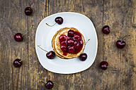 Stack of American pancakes with cherries and cherry groats - LVF005076