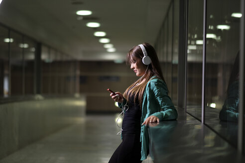 Young woman with headphones and smartphone - SIPF000586