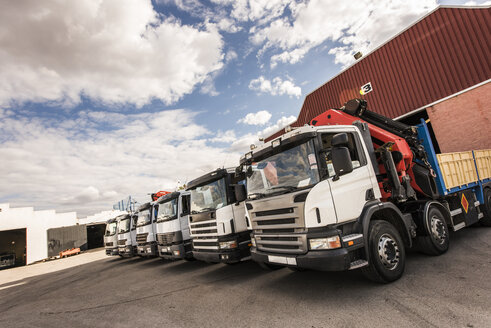 Row of trucks on company car park - JASF000966