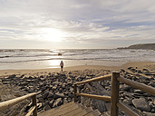 Portugal, Senior man taking a stroll at the beach - LAF001684