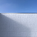 Concrete wall in front of blue sky, 3D Rendering - UW000914