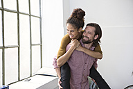 Happy couple in new flat piggybacking - RBF004604