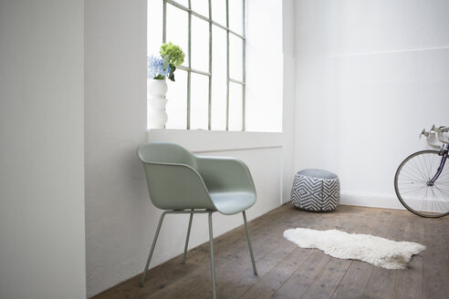 Modern home interior, chair and stool at window - RBF004634