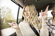 Portrait of young woman with eyes closed listening music in a car - PESF000193