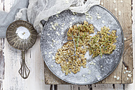 Baked elder flowers with icing sugar on plate - SBDF003016