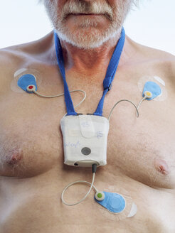 Senior man with long-term ECG on his chest, close up - LAF001704