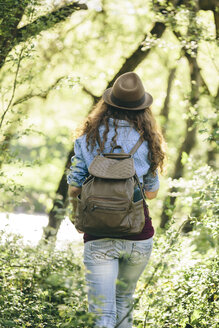 Back view of hiking young woman with backpack - AKNF000054