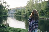Bulgaria, Sofia, back view of young woman looking at Lake Pancharevo - AKNF000063