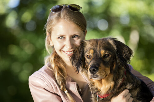 Portrait of happy woman with her mongrel - MIDF000741