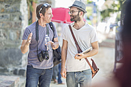 Two men walking and talking in the city - ZEF008973