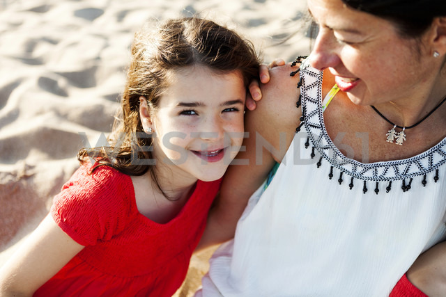 Portrait of happy little girl besides her mother on the beach - VABF000694