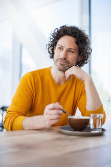 Portrait of pensive man with cup of Cappuccino - DIGF000571