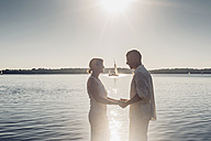 Couple standing at Lake Cospuden in the evening - MJF001973