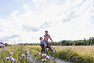 Happy young couple on a bicycle tour - UUF008147