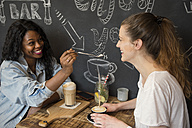 Two friends meeting in cafe, sharing coffee - ONF000944