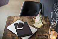 Mobile devices on table in a cafe - ONF000950