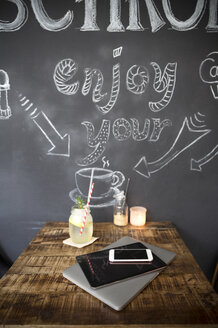 Mobile devices on table in a cafe - ONF000953