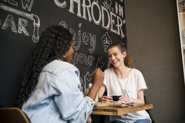 Two friends meeting in cafe, chatting - ONF000998