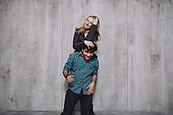 Young couple in front of concrete wall - GCF000215