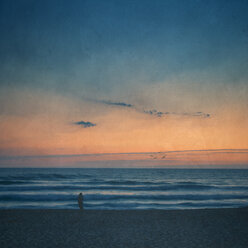 Silhouette of man on the beach at sunset - DWIF000763