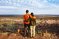 Namibia, embracing couple overlooking the vast plains in the african savannah from a natural viewpoint - GEMF000924