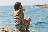 Woman with summer clothes looking out to sea on the beach of Blanes - SKCF000110
