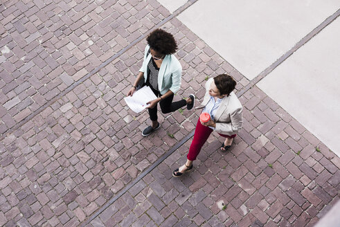 Two businesswomen walking side by side, seen from above - UUF008168