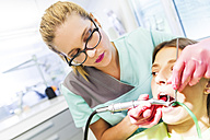 Patieint receiving treatment at the dentist - ZEDF000223