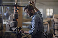 South Africa, Cape Town, cooperage, cooper working on old machine - ZEF009142