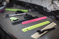 Combs and equipment laid out on table at barbershop - ZEF009214